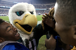 Eagles mascot Swoop drops in for a selfie.<br /> <br /> Football players of PIAA AAA State champions Imhotep Panthers and Pop Warner Midget Div. I National Champions NW Raiders got invited to see the December 26, 2015 NFC East Division game between Washington Redskins and Philadelphia Eagles at Lincoln Financial. 9photo by Bastiaan Slabbers)