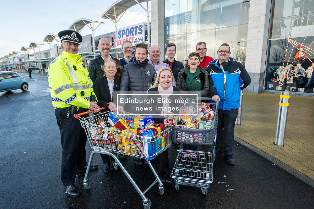 Pictured: Councillor Kelly Parry and Community Inspector John Dryden were joined by representatatives from the retailers located in the area such as Costco, Argos, Next; Dunelm; and Asda<br /> <br /> Midlothian Council has been working with Police Scotland to ensure the safety of residents, whether at home or out and about. The partnership has also been working witn retailers located at the Staiton retail park to gather contributions for Midlothian Food Bank to distribute to those in need.<br /> <br /> Ger Harley   EEm 22 December 2016