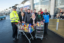 Pictured: Councillor Kelly Parry and Community Inspector John Dryden were joined by representatatives from the retailers located in the area such as Costco, Argos, Next; Dunelm; and Asda<br /> <br /> Midlothian Council has been working with Police Scotland to ensure the safety of residents, whether at home or out and about. The partnership has also been working witn retailers located at the Staiton retail park to gather contributions for Midlothian Food Bank to distribute to those in need.<br /> <br /> Ger Harley | EEm 22 December 2016