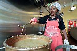 21 September 2015. New Orleans, Louisiana.<br /> Ms Mary Richardson making Aunt Sally's Pralines.<br /> Photo©; Charlie Varley/varleypix.com