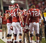 Nov 12, 2011; Fayetteville, AR, USA;  Arkansas Razorbacks head coach Bobby Petrino talks with center offensive tackle Brey Cook (74) and offensive guard Grant Cook (72) during a game against the Tennessee Volunteers at Donald W. Reynolds Razorback Stadium. Arkansas defeated Tennessee 49-7. Mandatory Credit: Beth Hall-US PRESSWIRE