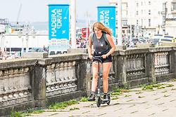 © Licensed to London News Pictures. 21/07/2019. Brighton, UK. Members of the public take advantage of the sunny and warm weather to spend time on the beach in Brighton and Hove. Photo credit: Hugo Michiels/LNP