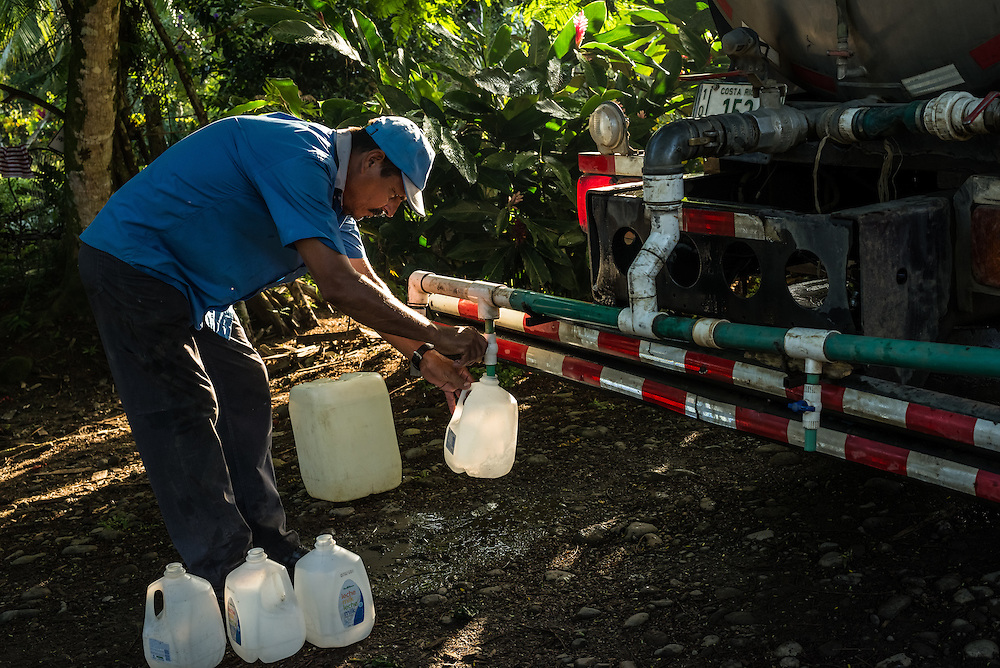 Clean water is delivered to residents of a small town where a nearby pineapple industrial farm operates.  Residents believe their water to be contaminated because of environmental failures at the pineapple plantation.