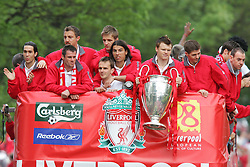 LIVERPOOL, ENGLAND - THURSDAY, MAY 26th, 2005: Liverpool players Luis Garcia, Jamie Carragher, Jerzy Dudek, Igor Biscan, Dietmar Hamann, Milan Baros, John Arne Riise and Steven Gerrard parade the European Champions Cup on on open-top bus tour of Liverpool in front of 500,000 fans after beating AC Milan in the UEFA Champions League Final at the Ataturk Olympic Stadium, Istanbul. (Pic by David Rawcliffe/Propaganda)