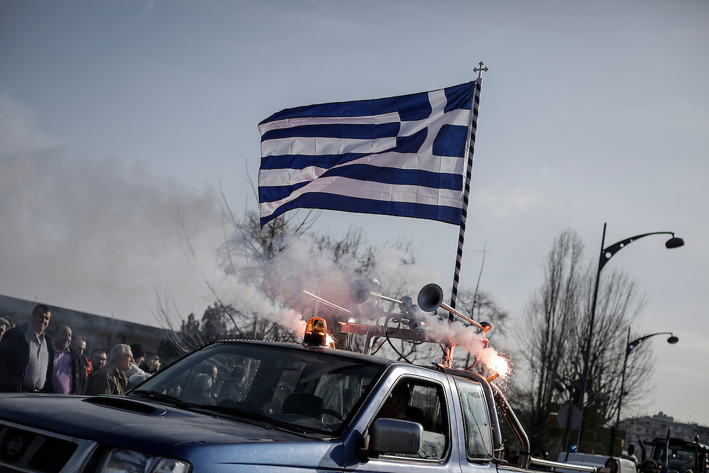 A car with the Greek flag on it during a march inside the city of Thessaloniki, Greece, on the 2nd of February 2017. Farmers from around northern Greece gathered in Thessaloniki during the opening of the Zootechnia international livestock to demonstrate against the austerity measures put by the Greek government.