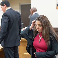 Assistant District Attorney Mandana Shousthari walks to reporters after the testimony and sentencing of former leader of the religious sect Aggressive Christianity James Green, at the 13th Judicial District Courthouse in Grants on Friday.