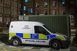 "© Licensed to London News Pictures . 25/05/2013 . Salford , UK . A police Crime Scene Investigation van parked at Salford Royal Hospital early this morning (Saturday 25th May) as two people have been arrested following reports of a man with a gun at Salford Royal Hospital in Greater Manchester yesterday evening (Friday 24th May) . A police statement said "" A man has been arrested on suspicion of possession of a section 1 firearm and false imprisonment, and a woman has been arrested on suspicion of possession of a section 1 firearm."" Photo credit : Joel Goodman/LNP"