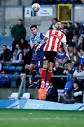 Joe Jacobson of Wycombe Wanderers heads the ball under pressure from Chris Maguire of Sunderland during the EFL Sky Bet League 1 match between Wycombe Wanderers and Sunderland at Adams Park, High Wycombe, England on 19 October 2019.
