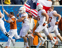 Nov 14, 2015; Morgantown, WV, USA; Texas Longhorns players run onto the field before their game against the West Virginia Mountaineers at Milan Puskar Stadium. Mandatory Credit: Ben Queen-USA TODAY Sports
