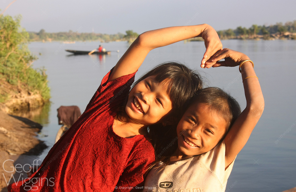 Local girls playing on the banks of the Mekong River Don Det Island, Lao