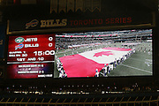 The Canadian flag is shown on the scoreboard display as it is flown on the field while their National Anthem is sung prior to the Buffalo Bills NFL football game against the New York Jets, December 3, 2009 in Toronto, Canada. The Jets won the game 19-13. ©Paul Anthony Spinelli
