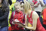 England Women GS Helen Housby signs an autograph after the Netball World Cup 2019 Preparation match between England Women and Uganda at Copper Box Arena, Queen Elizabeth Olympic Park, United Kingdom on 30 November 2018.