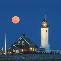 New England photography of Scituate Lighthouse with Worm full moon rising. This beautiful Massachusetts lighthouse is located on Cedar Point in Scituate Massachusetts.<br />