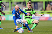 Forest Green Rovers George Williams(11) is found by Macclesfield Town's Danny Whittaker(23) who recieves a yellow card, booked during the EFL Sky Bet League 2 match between Forest Green Rovers and Macclesfield Town at the New Lawn, Forest Green, United Kingdom on 13 April 2019.