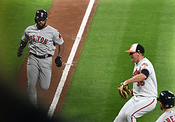 September 19, 2017 - Baltimore, MD, USA - The Boston Red Sox's Jackie Bradley Jr., left, races for home ahead of Baltimore Orioles pitcher Brad Brach, right, who tries to cover home after throwing a wild pitch in the 11th inning at Oriole Park at Camden Yards in Baltimore on Tuesday, Sept. 19, 2017. Bradley was safe as the Red Sox won, 1-0, in 11 innings. (Credit Image: © Kenneth K. Lam/TNS via ZUMA Wire)