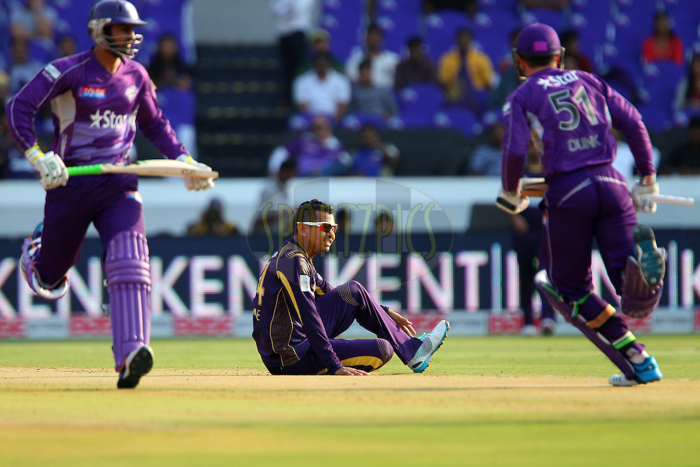 Sunil NARINE of the Kolkata Knight Riders looks on after slipping during the first semi final match of the Oppo Champions League Twenty20 between the Kolkata Knight Riders and the Hobart Hurricanes held at the Rajiv Gandhi Cricket Stadium, Hyderabad, India on the 2nd October 2014<br /> <br /> Photo by:  Ron Gaunt / Sportzpics/ CLT20<br /> <br /> <br /> Image use is subject to the terms and conditions as laid out by the BCCI/ CLT20.  The terms and conditions can be downloaded here:<br /> <br /> http://sportzpics.photoshelter.com/gallery/CLT20-Image-Terms-and-Conditions-2014/G0000IfNJn535VPU/C0000QhhKadWcjYs