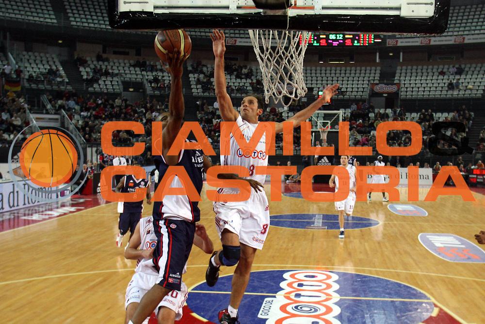 DESCRIZIONE : Roma Lega A1 2006-07 Lottomatica Virtus Roma Angelico Biella <br />GIOCATORE : Tonolli<br />SQUADRA : Lottomatica Virtus Roma <br />EVENTO : Campionato Lega A1 2006-2007 <br />GARA : Lottomatica Virtus Roma Angelico Biella <br />DATA : 30/12/2006 <br />CATEGORIA : Stoppata<br />SPORT : Pallacanestro <br />AUTORE : Agenzia Ciamillo-Castoria/M.Marchi<br />Galleria : Lega Basket A1 2006-2007 <br />Fotonotizia : Roma Campionato Italiano Lega A1 2006-2007 Lottomatica Virtus Roma Angelico Biella  <br />Predefinita :