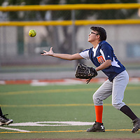 Tiger Erin Silago (4) reaches for a fly ball from the Tigers as it bounces in the outfield Tuesday at Ford Canyon Park.