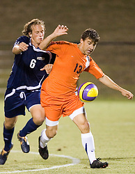 Virginia Cavaliers F Chase Neinken (13) holds off Mount Saint Mary's Mountaineers MF Ty Fenstermacher (6).  The #4 ranked Virginia Cavaliers men's soccer team defeated the Mount Saint Mary's Mountaineers 3-0 at Klockner Stadium in Charlottesville, VA on September 25, 2007.