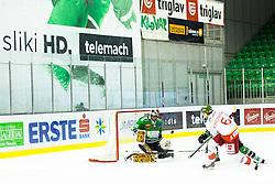 23.10.2014, Hala Tivoli, Ljubljana, SLO, EBEL, HDD Telemach Olimpija Ljubljana vs HC Bolzano Südtirol, 13. Runde, in picture Sean McMonagle (HC Bolzano Sudtirol, #6) shoots against Andy Chiodo (HDD Telemach Olimpija, #40) during the Erste Bank Icehockey League 13. Round between HDD Telemach Olimpija Ljubljana and  HC Bolzano Südtirol at the Hala Tivoli, Ljubljana, Slovenia on 2014/10/23. Photo by Matic Klansek Velej / Sportida