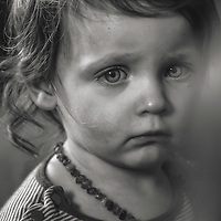 A young girl looking worried
