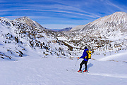 Backcountry skier in Little Lakes Valley, Inyo National Forest, Sierra Nevada Mountains, California