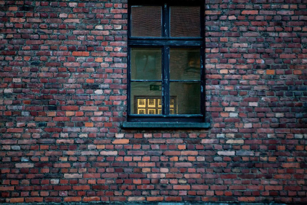 A look from outside into one of the blocks and photographs of former prisoners at the Auschwitz  Nazi concentration camp. It is estimated that between 1.1 and 1.5 million Jews, Poles, Roma and others were killed in Auschwitz during the Holocaust in between 1940-1945.