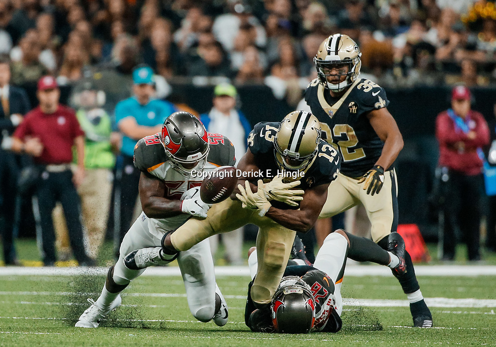 Sep 9, 2018; New Orleans, LA, USA; Tampa Bay Buccaneers linebacker Kwon Alexander (58) forces a fumble by New Orleans Saints wide receiver Michael Thomas (13) during the third quarter of a game at the Mercedes-Benz Superdome. The Buccaneers defeated the Saints 48-40. Mandatory Credit: Derick E. Hingle-USA TODAY Sports