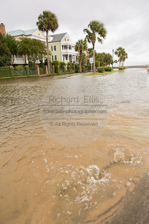 Water bubbles up through the sidewalk along Murray Blvd in the historic district after record breaking storms dumped more than two feet of rain on the lowcountry October 5, 2015 in Charleston, South Carolina.