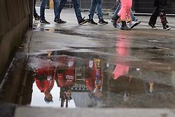 23.02.2017, Koeln, GER, Karneval, Weiberfastnacht, im Bild Jecken spiegeln sich in Pfuetze // during Women's Night of Cologne Carnival 2017. Koeln, Germany on 2017/02/23. EXPA Pictures © 2017, PhotoCredit: EXPA/ Eibner-Pressefoto/ Schueler<br /> <br /> *****ATTENTION - OUT of GER*****
