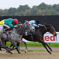 Forgive and S De Sousa winning the 2.50 race