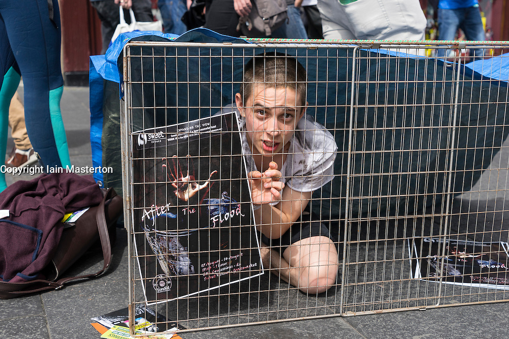 Actor promoting theatre show on  High Street during Edinburgh Fringe Festival 2016 in Scotland , United Kingdom