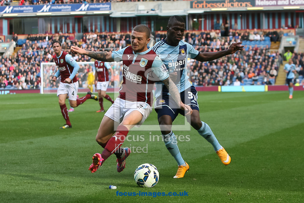 Kieran Trippier of Burnley and Enner Valencia of West Ham United compete for the ball during the Barclays Premier League match at Turf Moor, Burnley<br /> Picture by Daniel Chesterton/Focus Images Ltd +44 7966 018899<br /> 18/10/2014