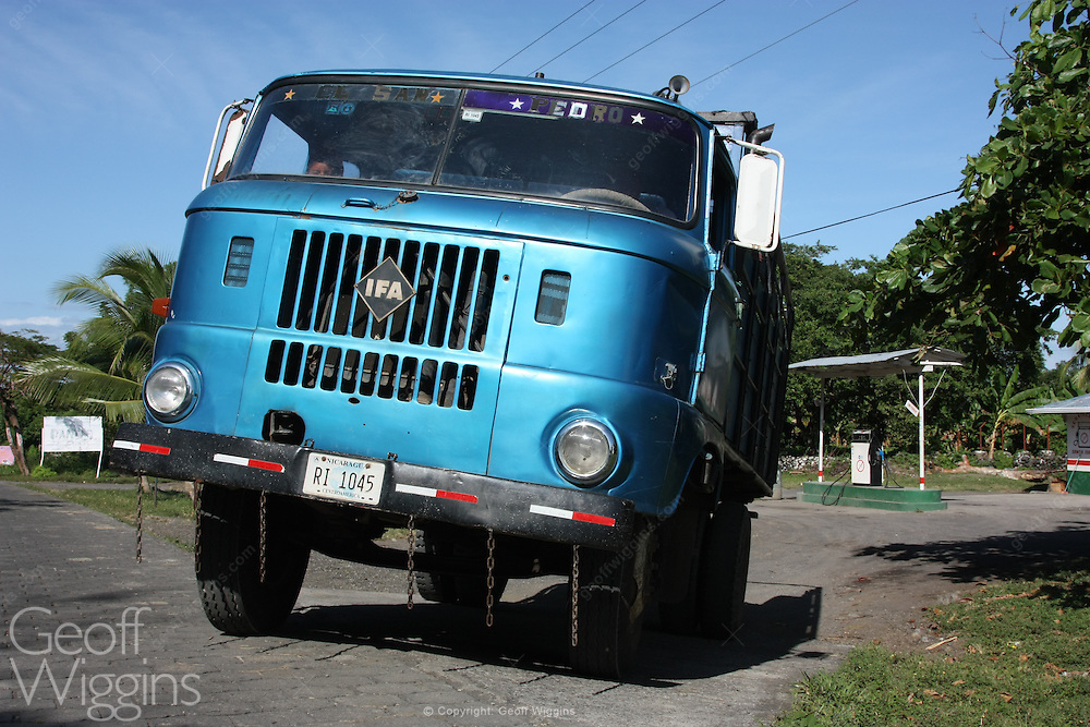 Vintage East German manufactured IFA W50 truck pulls out of country gas station, Ometepe, Nicaragua