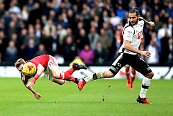 Ben Osborn of Nottingham Forest is tripped by Bradley Johnson of Derby County - Mandatory by-line: Robbie Stephenson/JMP - 11/12/2016 - FOOTBALL - iPro Stadium - Derby, England - Derby County v Nottingham Forest - Sky Bet Championship