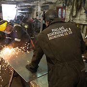 Mallaig Boatyard. Ian MacLeod (L), fabricator welder  cutting steel . Picture Robert Perry 9th April 2016<br /> <br /> Must credit photo to Robert Perry<br /> FEE PAYABLE FOR REPRO USE<br /> FEE PAYABLE FOR ALL INTERNET USE<br /> www.robertperry.co.uk<br /> NB -This image is not to be distributed without the prior consent of the copyright holder.<br /> in using this image you agree to abide by terms and conditions as stated in this caption.<br /> All monies payable to Robert Perry<br /> <br /> (PLEASE DO NOT REMOVE THIS CAPTION)<br /> This image is intended for Editorial use (e.g. news). Any commercial or promotional use requires additional clearance. <br /> Copyright 2014 All rights protected.<br /> first use only<br /> contact details<br /> Robert Perry     <br /> 07702 631 477<br /> robertperryphotos@gmail.com<br /> no internet usage without prior consent.         <br /> Robert Perry reserves the right to pursue unauthorised use of this image . If you violate my intellectual property you may be liable for  damages, loss of income, and profits you derive from the use of this image.