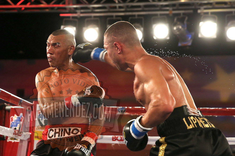 Sergei Lipinets (R) punches Cosme Rivera during a Telemundo Boxeo boxing match at the A La Carte Pavilion on Friday,  March 13, 2015 in Tampa, Florida.  Lipinets won the bout. (AP Photo/Alex Menendez)