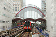 UK, London, Docklands, Dockland light railway trains leaving Canary Wharf station.<br /> <br /> September 2014<br /> <br /> &copy; Zute Lightfoot Photography