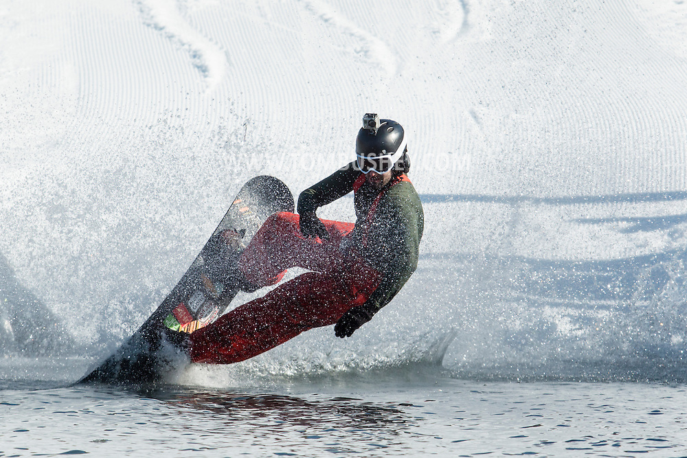A snowboarder stars to fall into the water during the Wacky Water Event at the Spring  Rally at Mount Peter Ski and Ride in Warwick, New York. The Spring Rally traditionally closes the season at the ski area.