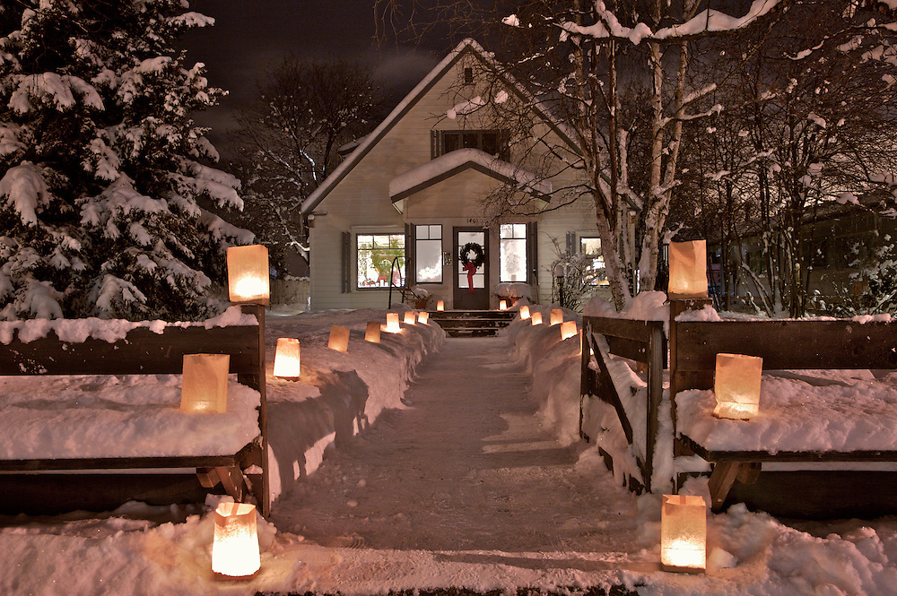 The Fleischer home in Anchorage's South Additiopn neighborhood welcomes Christmas guests with paper lumenaria.