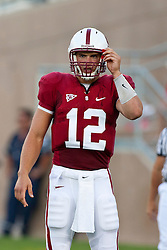 September 26, 2009; Stanford, CA, USA; Stanford Cardinal quarterback Andrew Luck (12) looks to the sidelines for a play call against the Washington Huskies during the first quarter at Stanford Stadium. Stanford defeated Washington 34-14. Mandatory Credit: Jason O. Watson-US PRESSWIRE