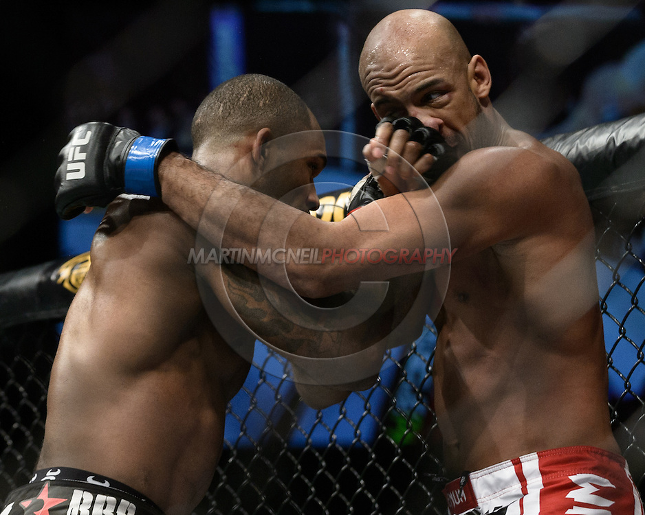 "LONDON, ENGLAND, FEBRUARY 16, 2013: Jimi Manuwa (L) catches Cyrille Diabate with a left uppercut during ""UFC on Fuel TV 7: Barao vs. McDonald"" inside Wembley Arena in Wembley, London on Saturday, February 16, 2013 (© Martin McNeil)"