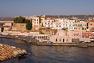 A view of tavernas around the harbour and the Kutchuk Hasan Mosque in the old town section of Hania, Crete, Greece