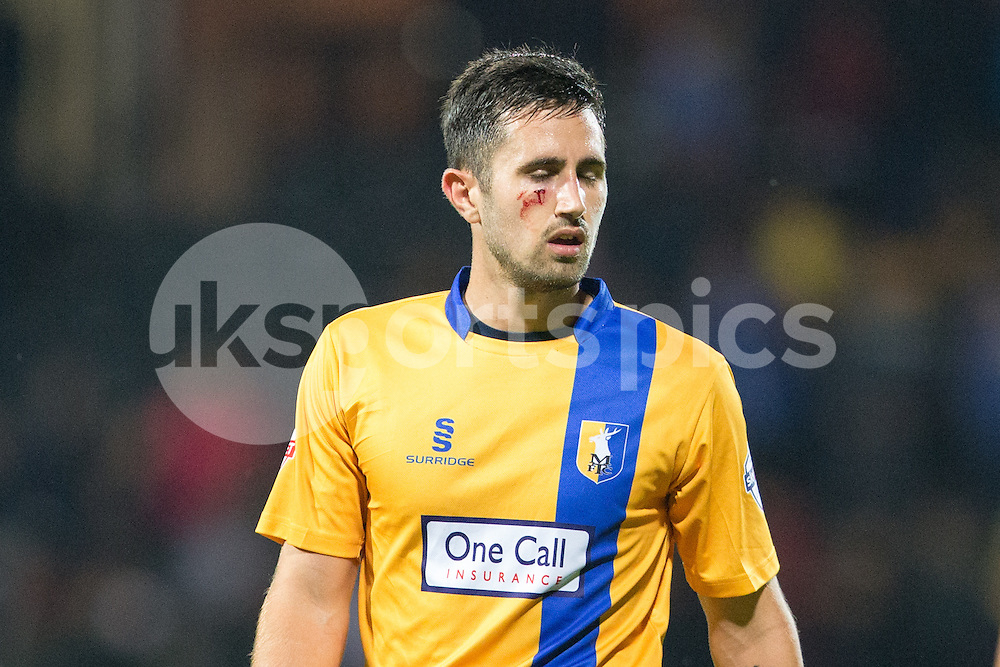 The price of victory Mansfield Town's first goalscorer Chris Clements sporting a cut cheek at full time during the Sky Bet League 2 match between Notts County and Mansfield Town at Meadow Lane, Nottingham, England on 14 August 2015. Photo by James Williamson.