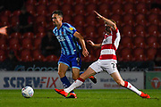 Blackpool forward Ryan Hardie (9) and Doncaster Rovers defender Brad Halliday (2) during the EFL Sky Bet League 1 match between Doncaster Rovers and Blackpool at the Keepmoat Stadium, Doncaster, England on 17 September 2019.