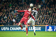 23.10.12. Copenhagen, Denmark. UEFA Champions League Group E, FC Nordsjaelland  1 vs Juventus 1 at the Parken Stadium. Bendtner (R) of Juventus fights for the ball with Runje (L) of FC Nordsjaelland during the UEFA Champions League. Photo: © Ricardo Ramirez..