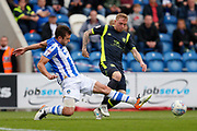 Colchester United's Doug Loft(8) makes a tackle Carlisle United's Nicholas Adams  during the EFL Sky Bet League 2 match between Colchester United and Carlisle United at the Weston Homes Community Stadium, Colchester, England on 14 October 2017. Photo by Phil Chaplin