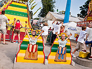 "01 SEPTEMBER 2011 - ST. PAUL, MN:  Girls look through photo cutouts in front of the Giant Slide at the Minnesota State Fair. The Minnesota State Fair is one of the largest state fairs in the United States. It's called ""the Great Minnesota Get Together"" and includes numerous agricultural exhibits, a vast midway with rides and games, horse shows and rodeos. Nearly two million people a year visit the fair, which is located in St. Paul. PHOTO BY JACK KURTZ"