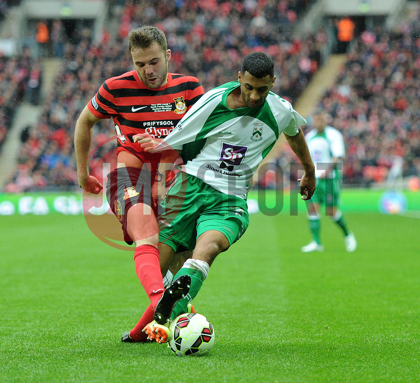 Wrexham's Steve Tomassen tussles with North Ferriby's Jason St Juste in FA Trophy Final at Wembley Stadium - Photo mandatory by-line: Paul Knight/JMP - Mobile: 07966 386802 - 29/03/2015 - SPORT - Football - London - Wembley Stadium - North Ferriby United v Wrexham - FA Trophy