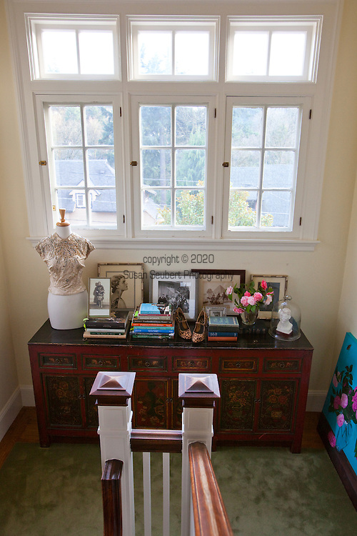 The Portland, Oregon home of Wendy Burden, author of  the memoir, Dead End Gene Pool.  The main stair landing which features a dress by Pierre Balmain and the portrait of her grandparents which is on the cover of the book.